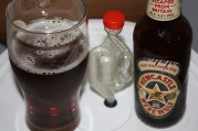 The beer triune: pint glass, airlock, bottle.