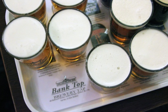 Don't drink the whole sampler flight by yourself, share it with the guy next to you.
